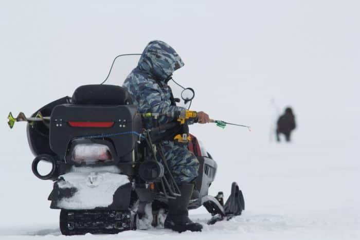 Handling A Snowmobile Ice Fishing